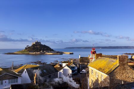 mediaeval: St Michaels Mount, Cornwall, England, from the village of Marazion. Stock Photo