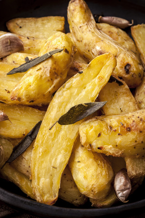 fingerling: Roast fingerling potatoes with sage, garlic and herbs. Stock Photo