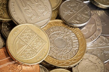 overhead view: British coins in full frame background.  Overhead view. Stock Photo