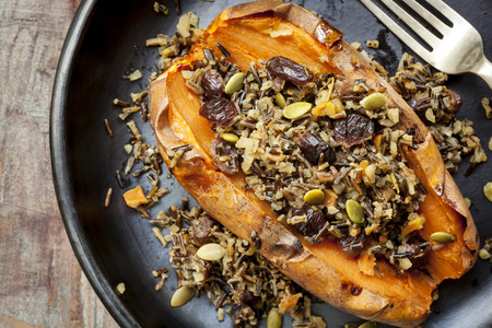 Baked sweet potato or yam, stuffed with wild rice, pepitas, and cranberries.