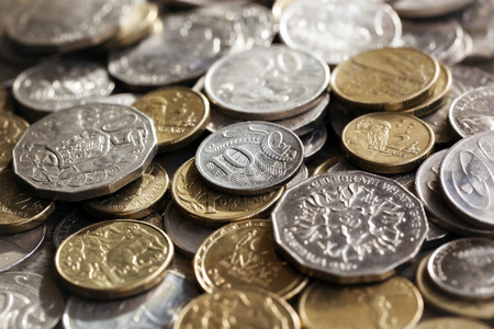 gold and silver coins: Australian money.  Scattered coins in full-frame background.