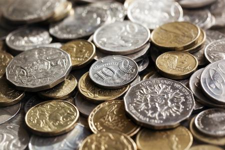 gold silver: Australian money.  Scattered coins in full-frame background.
