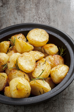 baked potato: Roast Potatoes with rosemary and sea salt, in black serving dish.