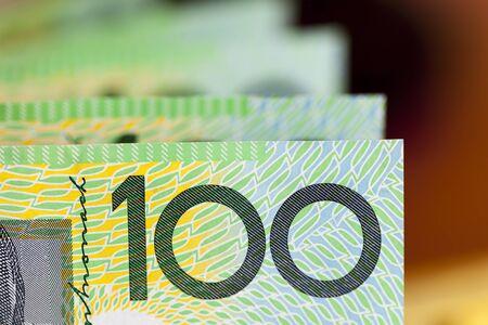 australian dollars: Australian one hundred dollar bills.  Blurred background.