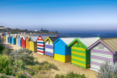 brighton beach: Brighton Beach bathing boxes, Melbourne, Australia.  Overlooking Port Phillip Bay.