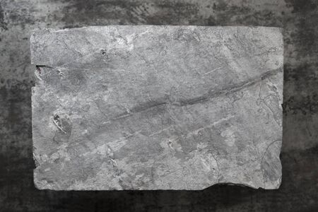 weathered: Slate background.  Gray slate over dark marble. Overhead view.