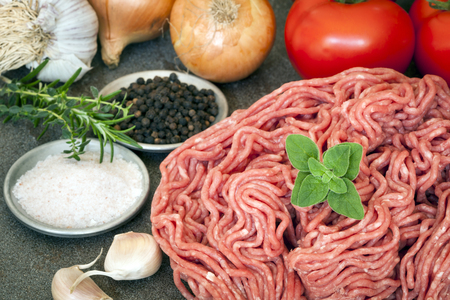 dark meat: Raw ground beef with tomatoes, onions, garlic, rosemary, salt and pepper.