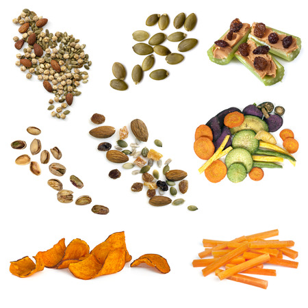 snacking: Healthy snacking collection isolated on white.  Includes seeds, nuts, trail mix, sweet potato fries, vegetable crisps and carrot sticks.