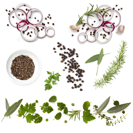 top down: Food background collection with onions, herbs, and peppercorns, all isolated on white.  Overhead view. Stock Photo