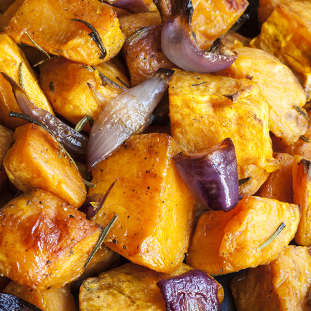 Roasted sweet potatoes with red onions and rosemary.