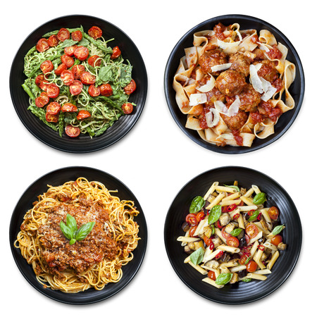 spaghetti: Pasta collage of meals on black plate, isolated on white.  Overhead view.  Includes spaghetti, fettucine, penne and ribbon.