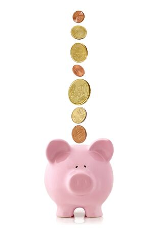 2 50: Euro coins falling into a pink piggy bank, isolated on white. Stock Photo