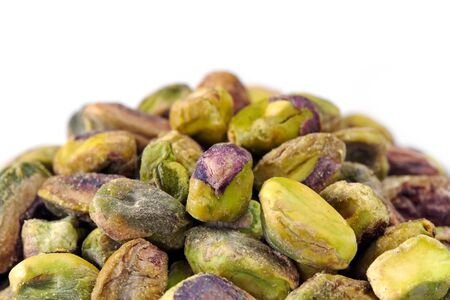 shelled: Pile of shelled pistachio nuts, over white background. Stock Photo