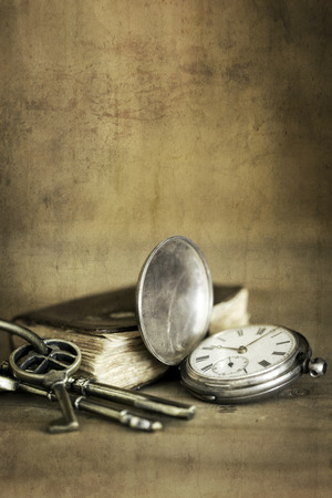pocket book: Vintage grunge still life with pocket watch, old book and brass keys. Stock Photo
