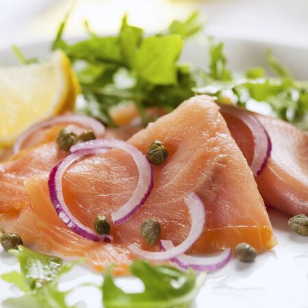 salmons: Smoked salmon salad with red onion, capers and arugula.