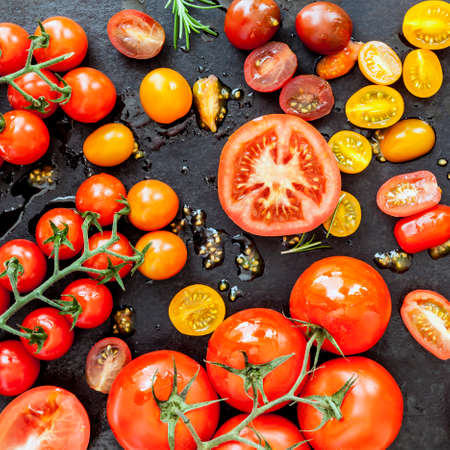 overhead view: Tomatoes background.  Different varieties, overhead view. Stock Photo