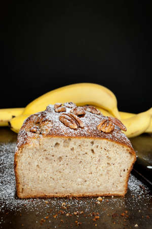 pecans: Banana bread with pecans.  Fresh-baked, over dark background. Stock Photo