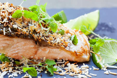 shredded coconut: Salmon grilled with lime and toasted coconut.  Garnished with micro herbs.