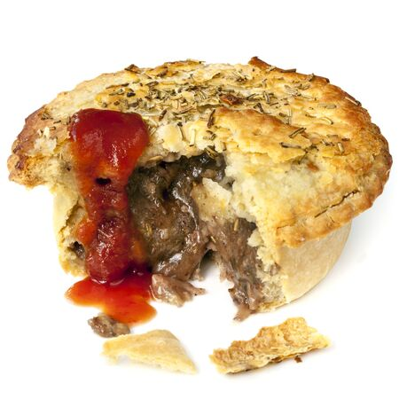 meat pie: Meat pie isolated on white.  Bite out, with tomato sauce.  Lamb with rosemary.