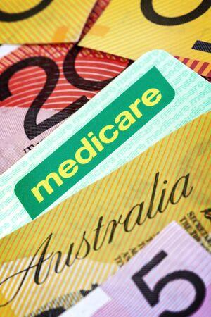 australian dollars: Australian Medicare card and money.