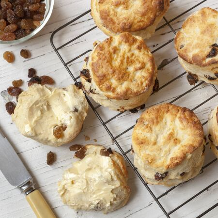 scones: Fruit scones on rack.  Top view.  With sultanas and butter.