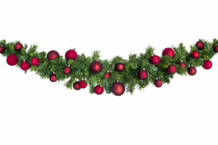 Christmas garland with red baubles.  Isolated on white. Stock Photo