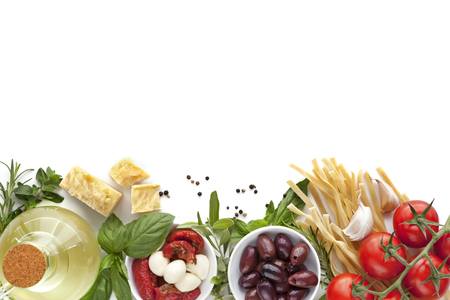 Italian food background over white.  Variety of ingredients, including olive oil, pasta, tomatoes, olives, herbs, parmesan and mozzarella. Standard-Bild