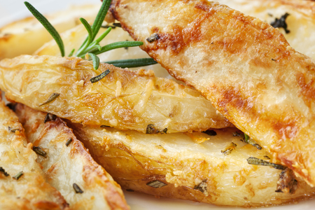 wedges: Potato wedges with parmesan and herbs.