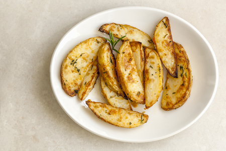 wedge: Potato wedges with parmesan and herbs.  Top view. Stock Photo