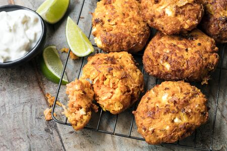 feta: Fritters with carrots, sweet potato and feta cheese, served with yogurt and lime.