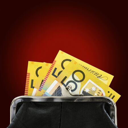 fifty dollar bill: Australian money in purse over glowing red background.