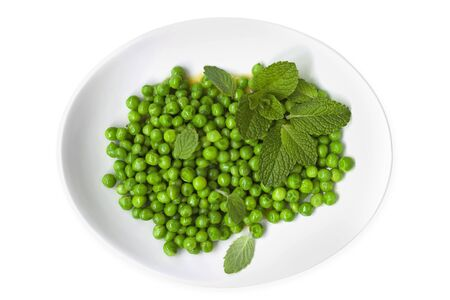 minted: Peas with mint on a white plate, top view.  Isolated.