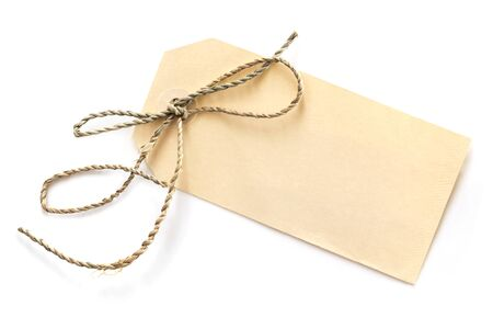 blank tag: Blank tag tied with brown string, isolated on white, top view.  Price tag, gift tag, sale tag, address label, etc.