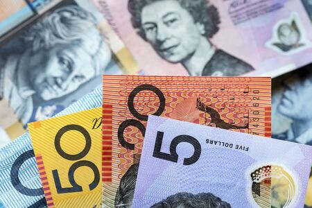 foreground focus: Australian money background.  Focus on foreground, blurred faces beneath. Stock Photo