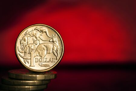 Australian money over vibrant red background. Banque d'images