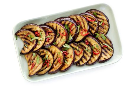 Grilled marinated eggplant slices isolated on white, top view.   Stock Photo