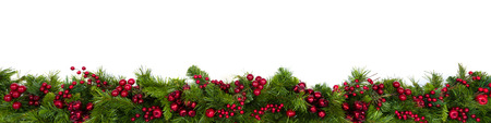 Christmas garland border with red berries, isolated on white.  Extra wide.