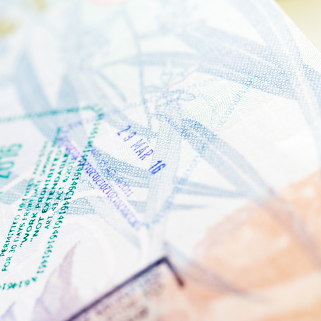 Travel background with passport visa stamps, blurred.