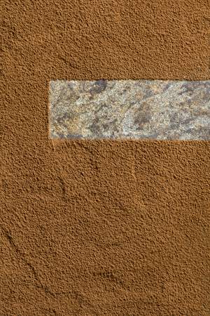 Cocoa powder background, sifted over stone with negative copy space.