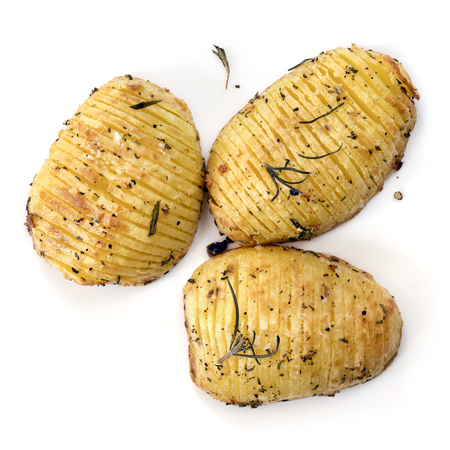 Hasselback potatoes with rosemary and sea salt.  Top view, isolated on white. Stockfoto
