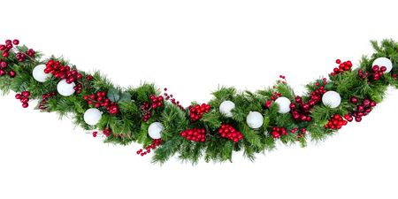 Christmas garland with red berries and silver baubles, isolated on white.