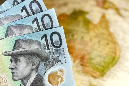 New Australian money over blurred map background