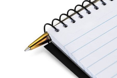 Spiral notebook with gold ballpoint pen, over white.  Closeup view. Stockfoto