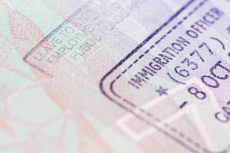 Passport visa stamps in soft focus.  Travel background.