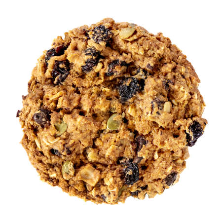 A home-made granola cookie, top view, isolated on white.  Delicious healthy snacking.