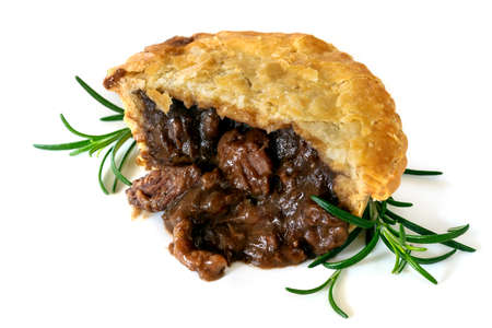 Meat pie with rosemary, cut, isolated on white background. Stockfoto