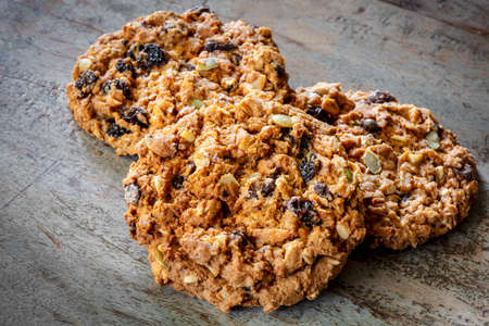 Granola cookies on rustic timber background.  Delicious healthy homebaked snack.