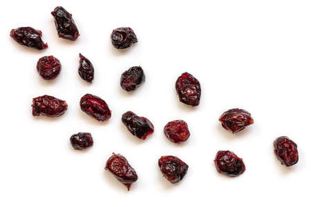 Dried cranberries isolated on white.  Top view, scattered. Stockfoto