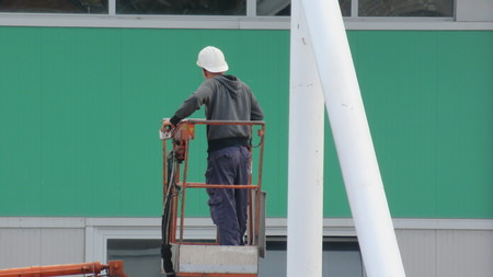 facelift: worker in the construction elevator