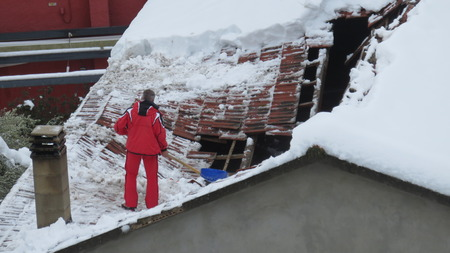 the collapsing: roof collapsed under the weight of snow Stock Photo